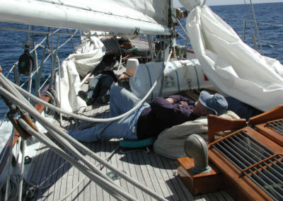 After a hard day of racing, this crew member takes a break on deck during the 2003 Newport to Ensenada race.