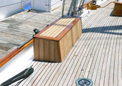 Deck boxes port and starboard to provide more seating and life vest storage.