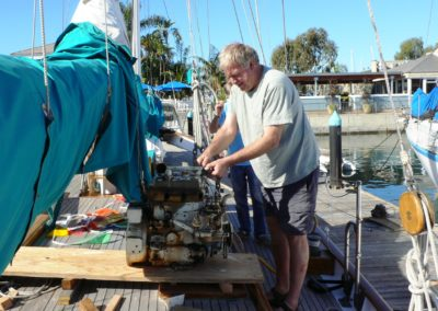 Ok it's out, now to get it off the boat. Here John Keith gets it ready for the second lift, this one to the dock.