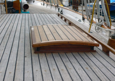 This deck hatch was remade in 2009 to follow he contours of the deck in the same way the main companionway hatch does.
